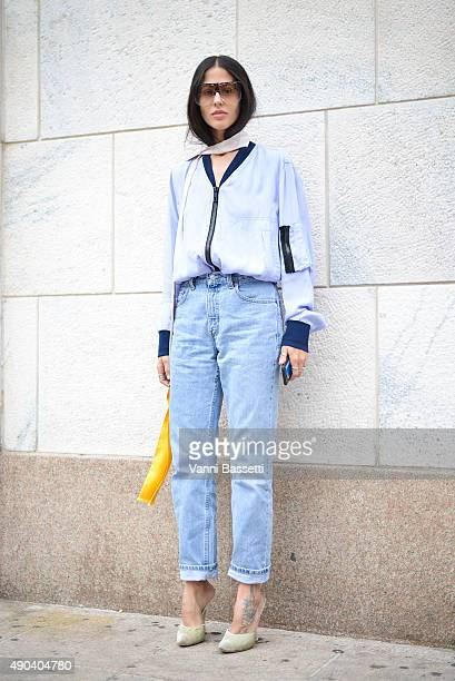 Gilda Ambrosio poses wearing an Andrea Pompilio shirt and Loewe sunnies before the Arthur Arbesser show during the Milan Fashion Week Spring/Summer...