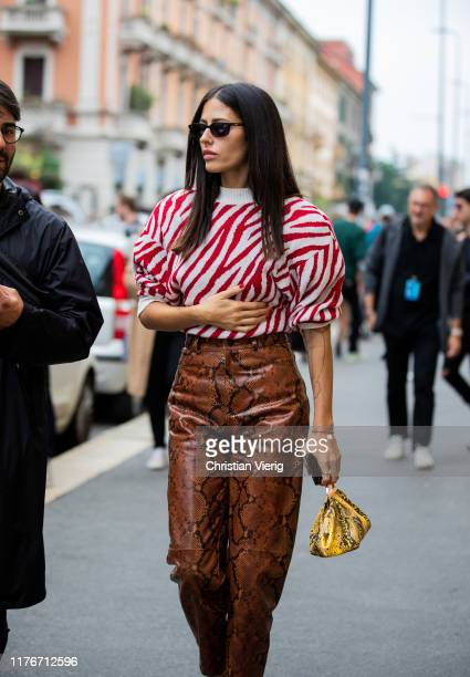 Gilda Ambrosio seen wearing red white striped top, brown pants with snake print outside Boss during Milan Fashion Week Spring/Summer 2020 on...