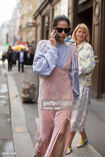Gilda Ambrosio talks on the phone after the Iris Van Herpen show at Eglise de lÕOratoire du Louvre on July 4 2016 in Paris France