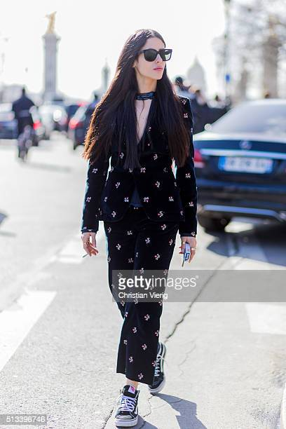 Gilda Ambrosio wearing a black velvet suit outside Maison Margiela during the Paris Fashion Week Womenswear Fall/Winter 2016/2017 on March 2 2016 in...