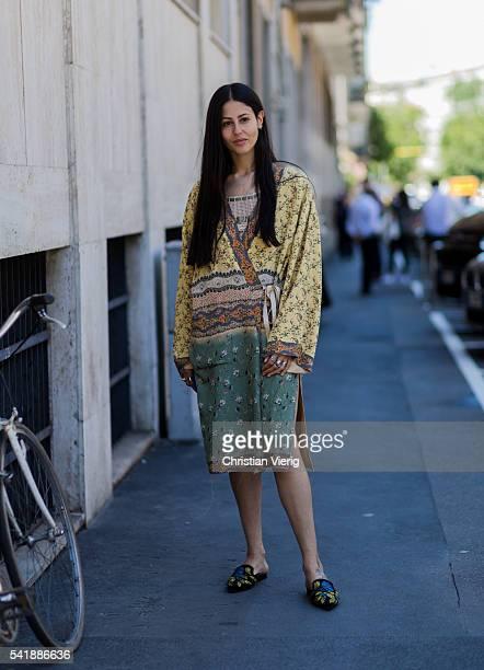 Gilda Ambrosio wearing a boho dress outside Etro during the Milan Men's Fashion Week Spring/Summer 2017 on June 20 2016 in Milan Italy
