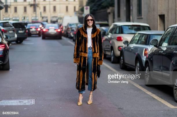 Gilda Ambrosio wearing a brown black fur coat denim jeans white tshirt outside Alberta Ferretti on February 22 2017 in Milan Italy