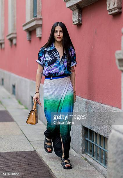 Gilda Ambrosio wearing a button shirt with floral print Missoni skirt and sandals outside Missoni during the Milan Men's Fashion Week Spring/Summer...