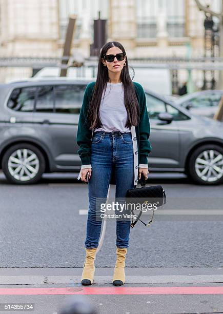 Gilda Ambrosio wearing a green cardigan blue denim jeans and a black Chanel bag and shoes outside Ellery during the Paris Fashion Week Womenswear...