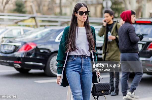 Gilda Ambrosio wearing a green cardigan blue denim jeans and a black Chanel bag outside Ellery during the Paris Fashion Week Womenswear Fall/Winter...