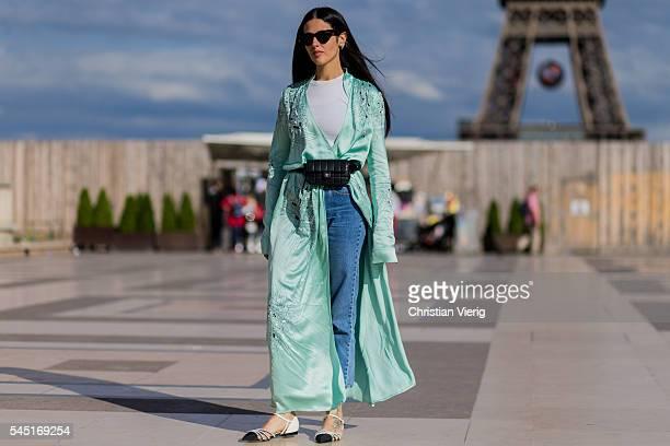 Gilda Ambrosio wearing a mint coat black Chanel bag denim jeans outside Giorgio Armani Prive during Paris Fashion Week Haute Couture F/W 2016/2017 on...