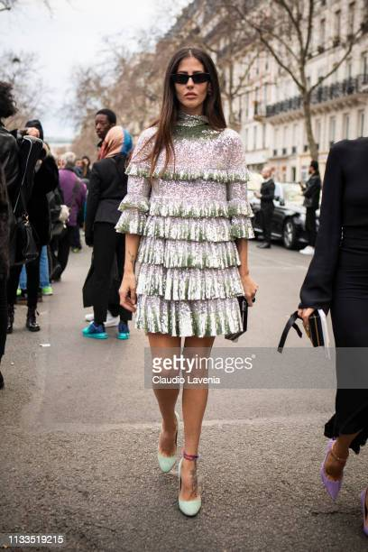 Gilda Ambrosio wearing a sequins silver mini dress and light green heels is seen outside Valentino on Day 7 Paris Fashion Week Autumn/Winter 2019/20...