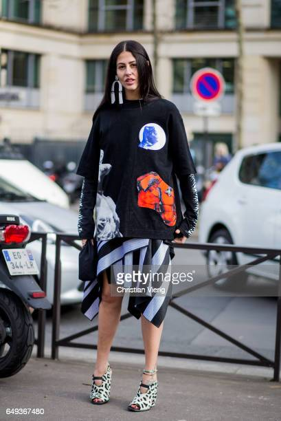 Gilda Ambrosio wearing a striped skirt outside Miu Miu on March 7 2017 in Paris France
