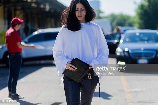 Gilda Ambrosio wearing a white shirt black leather pants outside Diesel during the Milan Men's Fashion Week Spring/Summer 2017 on June 20 2016 in...