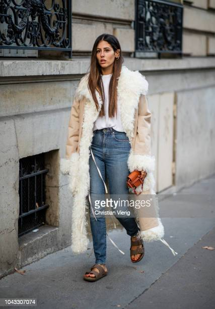 Gilda Ambrosio wearing denim jeans, Birkenstock sandals is seen outside Alessandra Rich during Paris Fashion Week Womenswear Spring/Summer 2019 on...