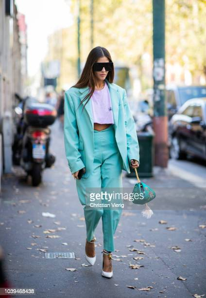 Gilda Ambrosio wearing oversized sunglasses mint pastel suit seen outside Marni during Milan Fashion Week Spring/Summer 2019 on September 23 2018 in...