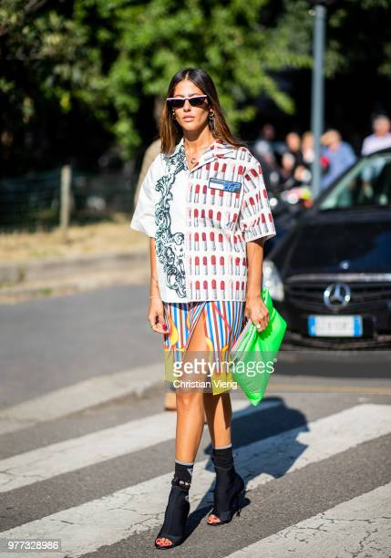 Gilda Ambrosio wearing Prada button skirt skirt ankle boots is seen outside Prada during Milan Men's Fashion Week Spring/Summer 2019 on June 17 2018...