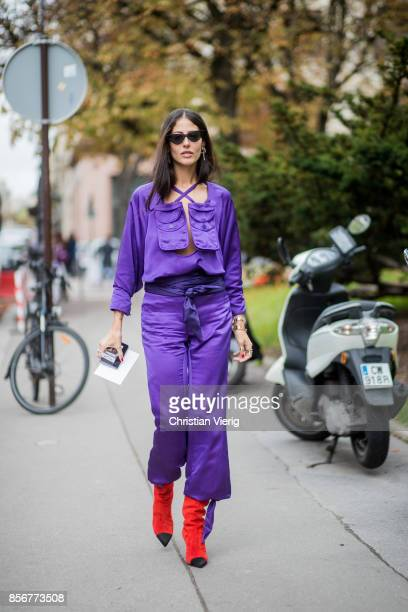 Gilda Ambrosio wearing purple overall seen outside Sacai during Paris Fashion Week Spring/Summer 2018 on October 2 2017 in Paris France