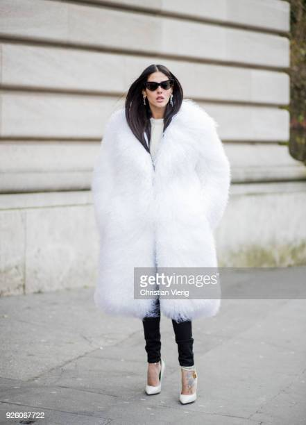 Gilda Ambrosio wearing white fluffy coat is seen outside Rochas on February 28 2018 in Paris France