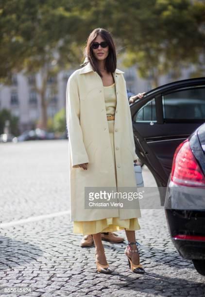 Gilda Ambrosio wearing yellow wool coat is seen outside Nina Ricci during Paris Fashion Week Spring/Summer 2018 on September 29 2017 in Paris France