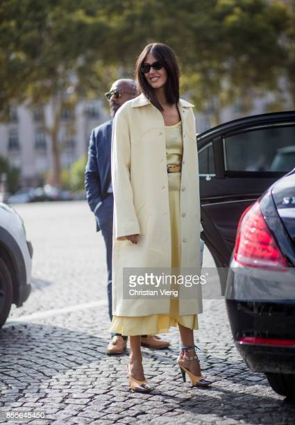 Gilda Ambrosio wearing yellow wool coat is seen outside Nina Ricci during Paris Fashion Week Spring/Summer 2018 on September 29 2017 in Paris France