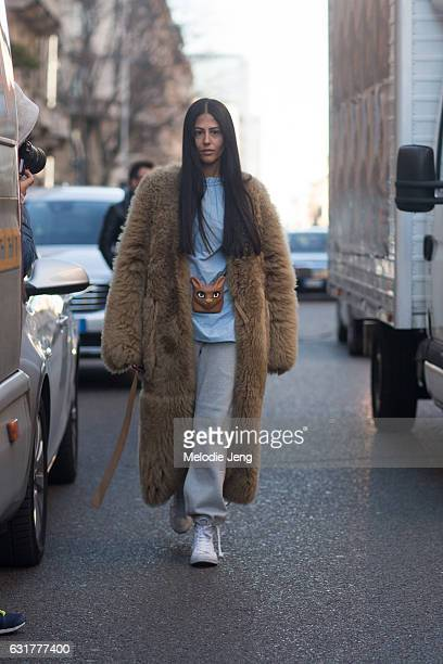 Gilda Ambrosio wears a brown fur coat with an animal accessory during Milan Men's Fashion Week Fall/Winter 2017/18 on January 15, 2017 in Milan,...