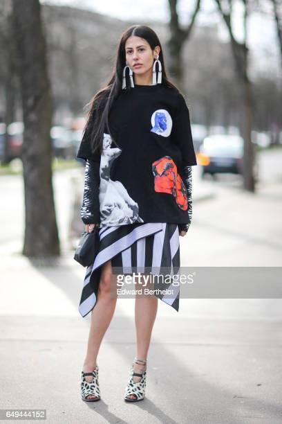 Gilda Ambrosio wears a Miu Miu dress outside the Miu Miu show during Paris Fashion Week Womenswear Fall/Winter 2017/2018 on March 7 2017 in Paris...