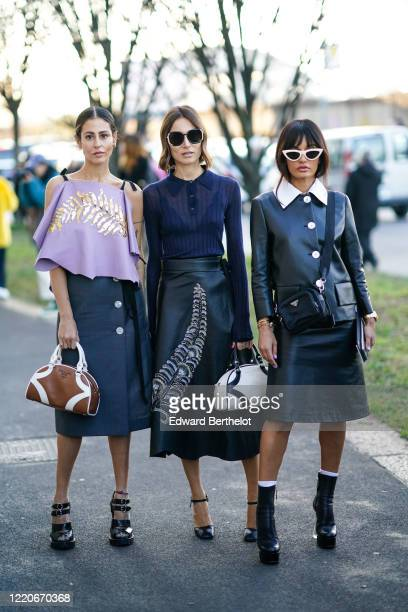 Gilda Ambrosio wears a purple top with a golden printed feather a blue skirt a brown leather Prada bag black shes a guest wears a blue top black...