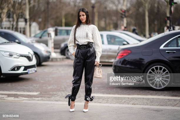 Gilda Ambrosio wears a white top black leather pants white shoes outside Chanel during Paris Fashion Week Womenswear Fall/Winter 2018/2019 on March 6...