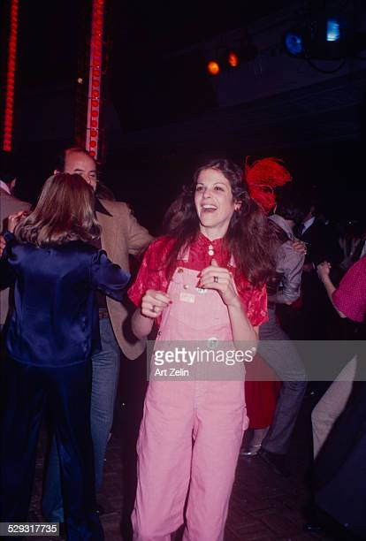 Gilda Radner wearing pink overalls at Studio 54 dancing circa 1970 New York
