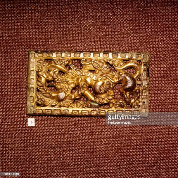 Gilded Bronze Harness Plaque of Two Animals Fighting Ordos Region c3rd century BC Victoria and Albert MuseumArtist Unknown