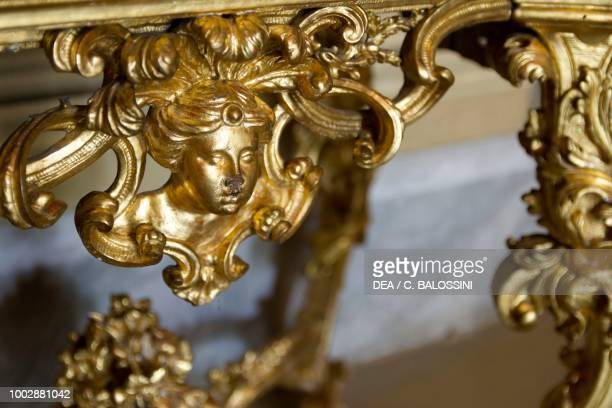 Gilded carving detail of the table base of the safe hall of perspectives by Giovanni Battista Alberoni Hunting residence by Filippo Juvarra Stupinigi...