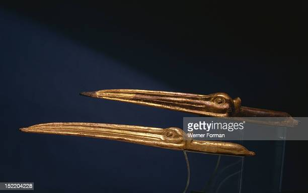 Gilded heads and bills of ibises sacred animals to Thoth the god of writing originally affixed to the bandages of mummified ibises During the...