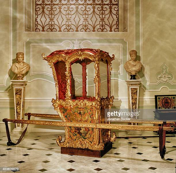 A gilded sedan chair in the entry hall to Prince Jonathans private quarters is photographed for Vanity Fair Magazine on April 26 2011 in the Palazzo...