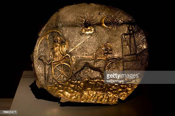 A gilded silver plate with Cybele on a chariot dated 3rd century BC is on display at the 'Hidden Afghanistan' Exhibition on December 20 2007 in...