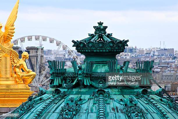 gilded statue and dome of palais garnier against sky - オペラ座 ストックフォトと画像