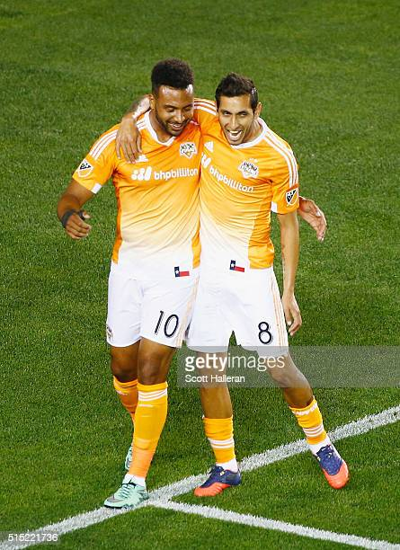 Giles Barnes and Cristian Maidana of the Houston Dynamo celebrate a firsthalf own goal against FC Dallas during their game at BBVA Compass Stadium on...
