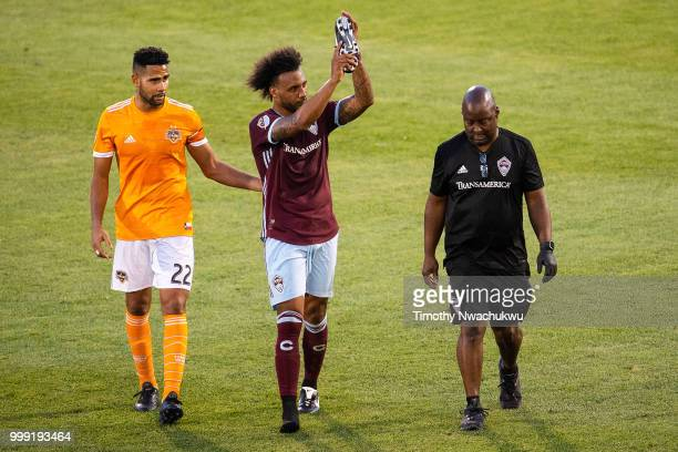 Giles Barnes of Colorado Rapids center applauds to supporters after suffering a leg injury against the Houston Dynamo at Dick's Sporting Goods Park...