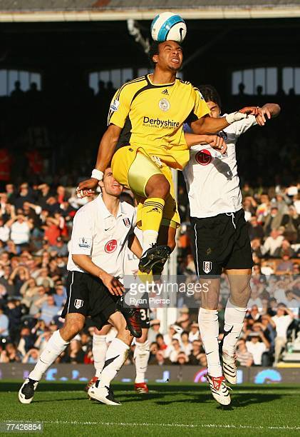 Giles Barnes of Derby County outjumps Dejan Stefanovic of Fulham during the Barclays Premier League match between Fulham and Derby County at Craven...