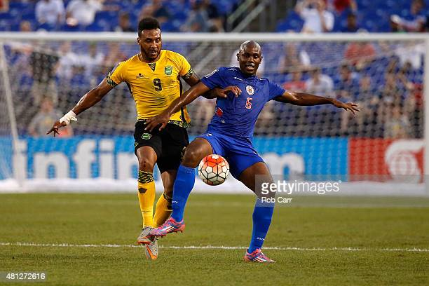 Giles Barnes of Jamaica and Frantz Bertin of Haiti go after the ball in the first half during the 2015 CONCACAF Gold Cup quarterfinal match at MT...