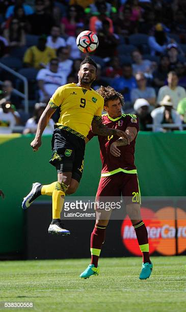 Giles Barnes of Jamaica and Rolf Feltscher of Venezuela during a group C match between Jamaica and Venezuela at Soldier Field Stadium as part of Copa...
