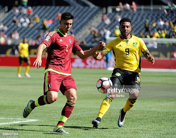 Giles Barnes of Jamaica and Wilker Angel of Venezuela go for the ball during a group C match between Jamaica and Venezuela at Soldier Field Stadium...