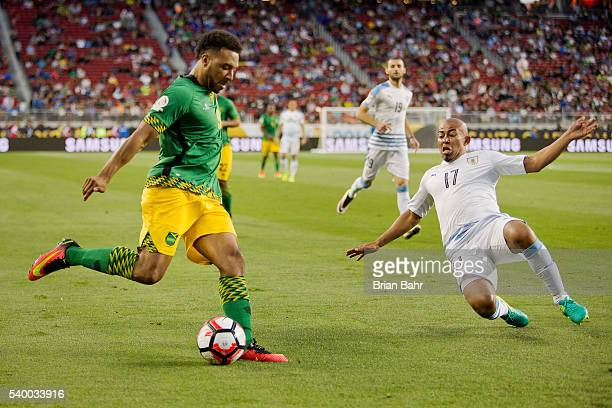 Giles Barnes of Jamaica fights for the ball with Egidio Arevalo Rios of Uruguay during a group C match between Uruguay and Jamaica at Levi's Stadium...
