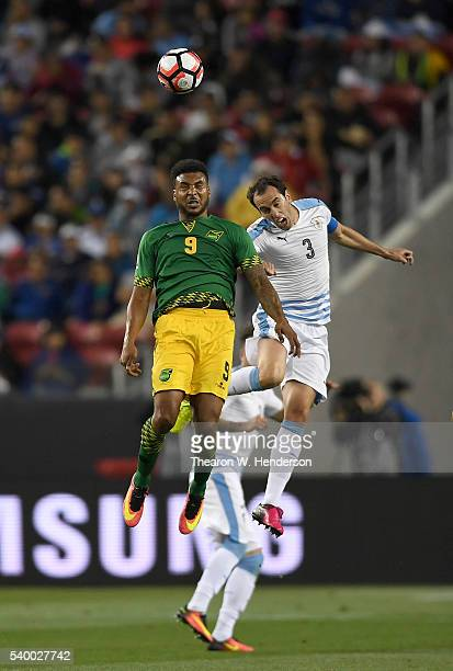 Giles Barnes of Jamaica hits a header away from Diego Godin of Uruguay during the 2016 Copa America Centenario Group match play between Uruguay and...