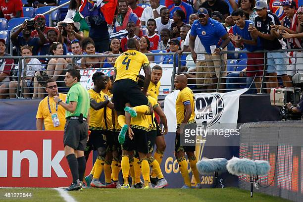 Giles Barnes of Jamaica is mobbed by teammates after scoring a first half goal against Haiti during the 2015 CONCACAF Gold Cup quarterfinal match at...