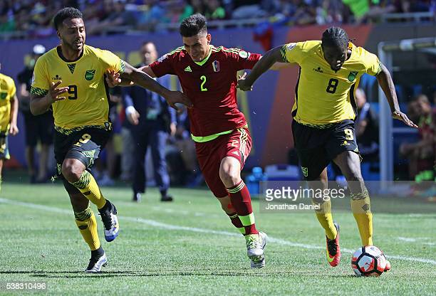 Giles Barnes of Jamaica Wuilker Angel of Venezuela and Clayton Donaldson of Jamaica chase down the ball during a match in the 2016 Copa America...
