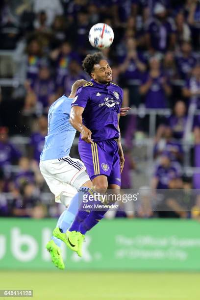 Giles Barnes of Orlando City SC and Alexander Ring of New York City FC fight for the ball during a MLS soccer match between New York City FC and...