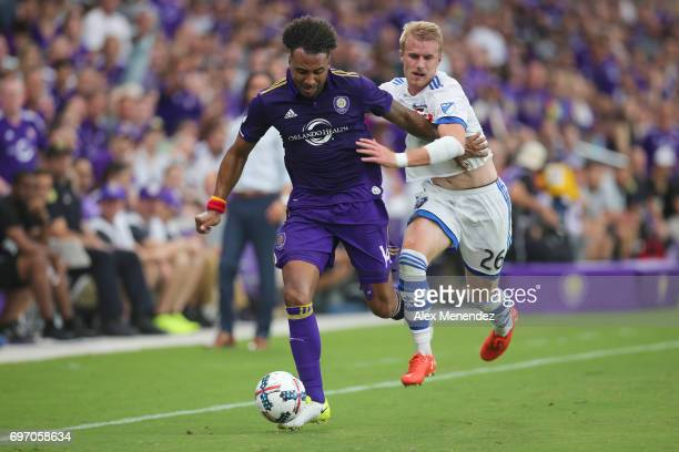 ORLANDO FL JUNE 17 Giles Barnes of Orlando City SC and Kyle Fisher of Montreal Impact fight for the ball during a MLS soccer match between the...