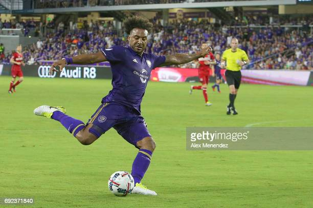 Giles Barnes of Orlando City SC kicks the ball during a MLS soccer match between the Chicago Fire and the Orlando City SC at Orlando City Stadium on...