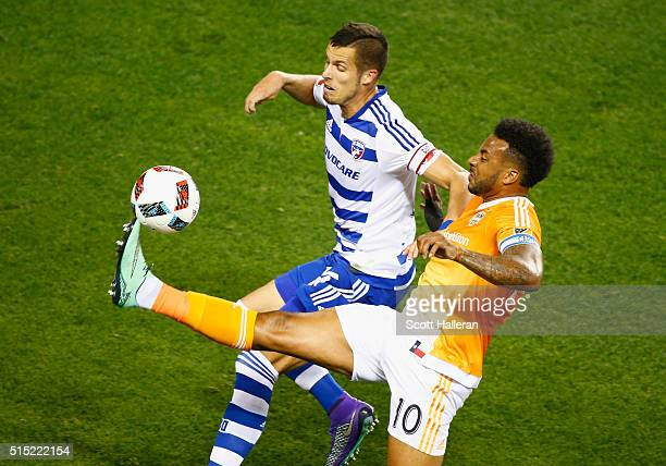 Giles Barnes of the Houston Dynamo battles for the ball with Matt Hedges of FC Dallas during their game at BBVA Compass Stadium on March 12 2016 in...
