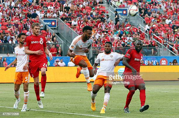 Giles Barnes of the Houston Dynamo clears the ball during an MLS soccer game against Toronto FC at BMO Field on May 10 2015 in Toronto Ontario Canada