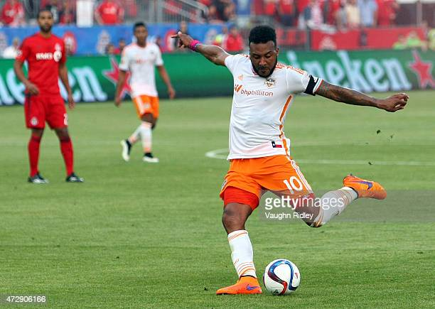 Giles Barnes of the Houston Dynamo has a shot on goal during an MLS soccer game against Toronto FC at BMO Field on May 10 2015 in Toronto Ontario...