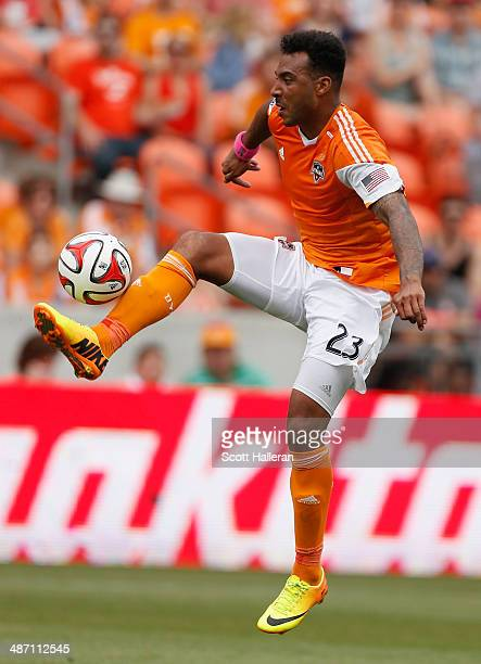 Giles Barnes of the Houston Dynamo works the ball against the Portland Timbers during the second half of their game at BBVA Compass Stadium on April...