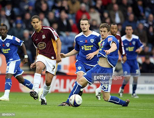 Giles Coke of Northampton Town plays the ball past Andy King of Leicester City during the Coca Cola League One Match between Leicester City and...