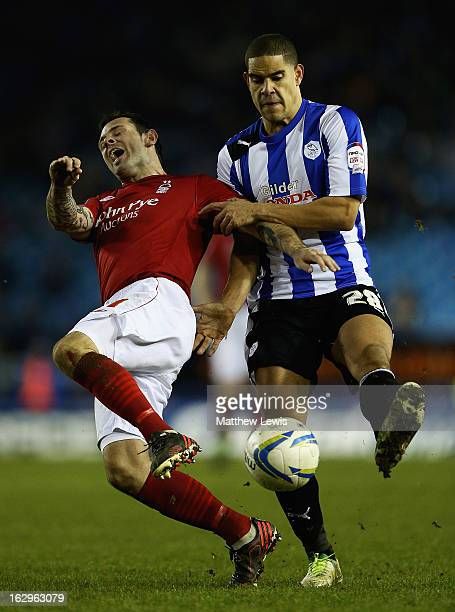 Giles Coke of Sheffield tackles Andy Reid of Nottingham during the npower Championship match between Sheffield Wednesday and Nottingham Forest at...